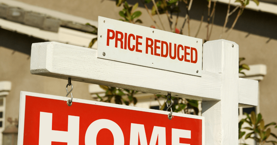 picture of a cheap house price reduction sign