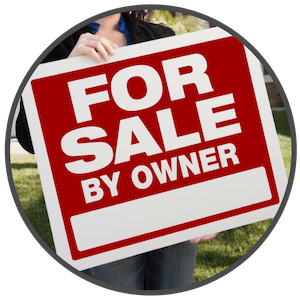 picture of a woman holding a for sale by owner sign